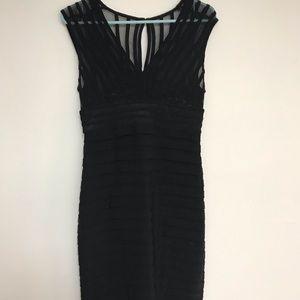Black V neck dress. Zipper back. Sheer bodice.